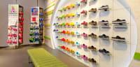 Wall display with footwear