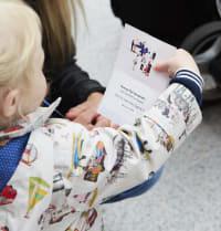 Child holding train wi-fi password card