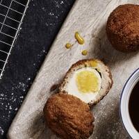 Scot egg on cutting board