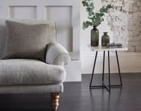 Grey fabric sofa with beige corner table