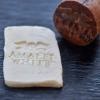 The Amalfi White logo on a wax seal