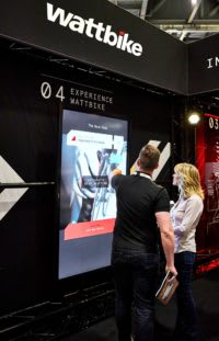 Photograph of a Wattbike staff member using the touchscreen