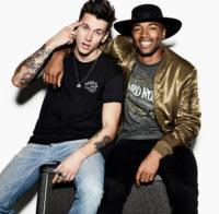 Two male models sat on Amplifier in Hard rock merchandise
