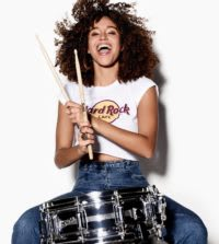 Model playing drums in Hard Rock t-shirt