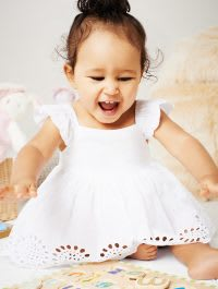 Young child in white dress