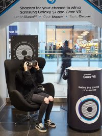 Woman trying on Samsung Gear VR