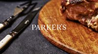 Parker's logo identity over picture of pork roast