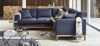 Man playing guitar on a corner sofa