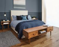 Bedroom double bed with navy throw and wooden end table