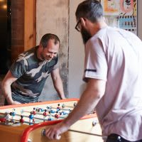 2 men playing table football
