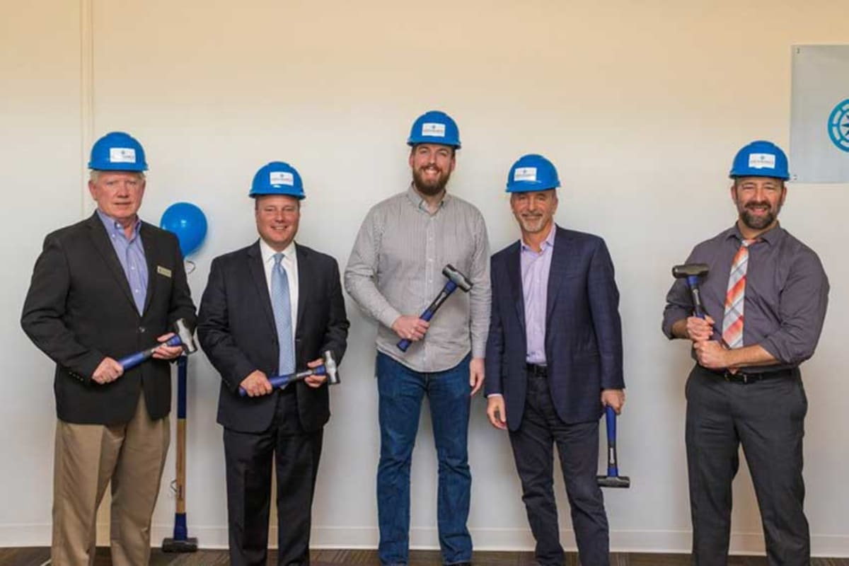 Arizona Commerce Authority's Kevin Sullivan, Tempe Mayor Mark Mitchell, Endurance Tempe Operations General Manager Andrew Wright, Endurance President & COO Ron LaSalvia and Scales Technology Academy Principal Stephen Wolf present at the groundbreaking at EIG's Tempe office location.