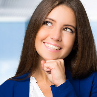 Woman smiling and thinking about whether to have cosmetic surgery.