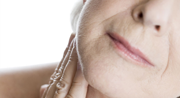 Closeup of older woman's nasolabial folds.