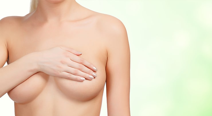 Woman covering her inverted nipple with her hand.