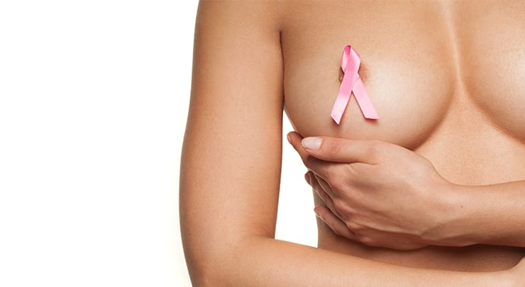 Woman with pink breast cancer ribbon on her breast.