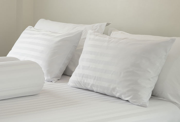 Pillows on bed for otoplasty patient.
