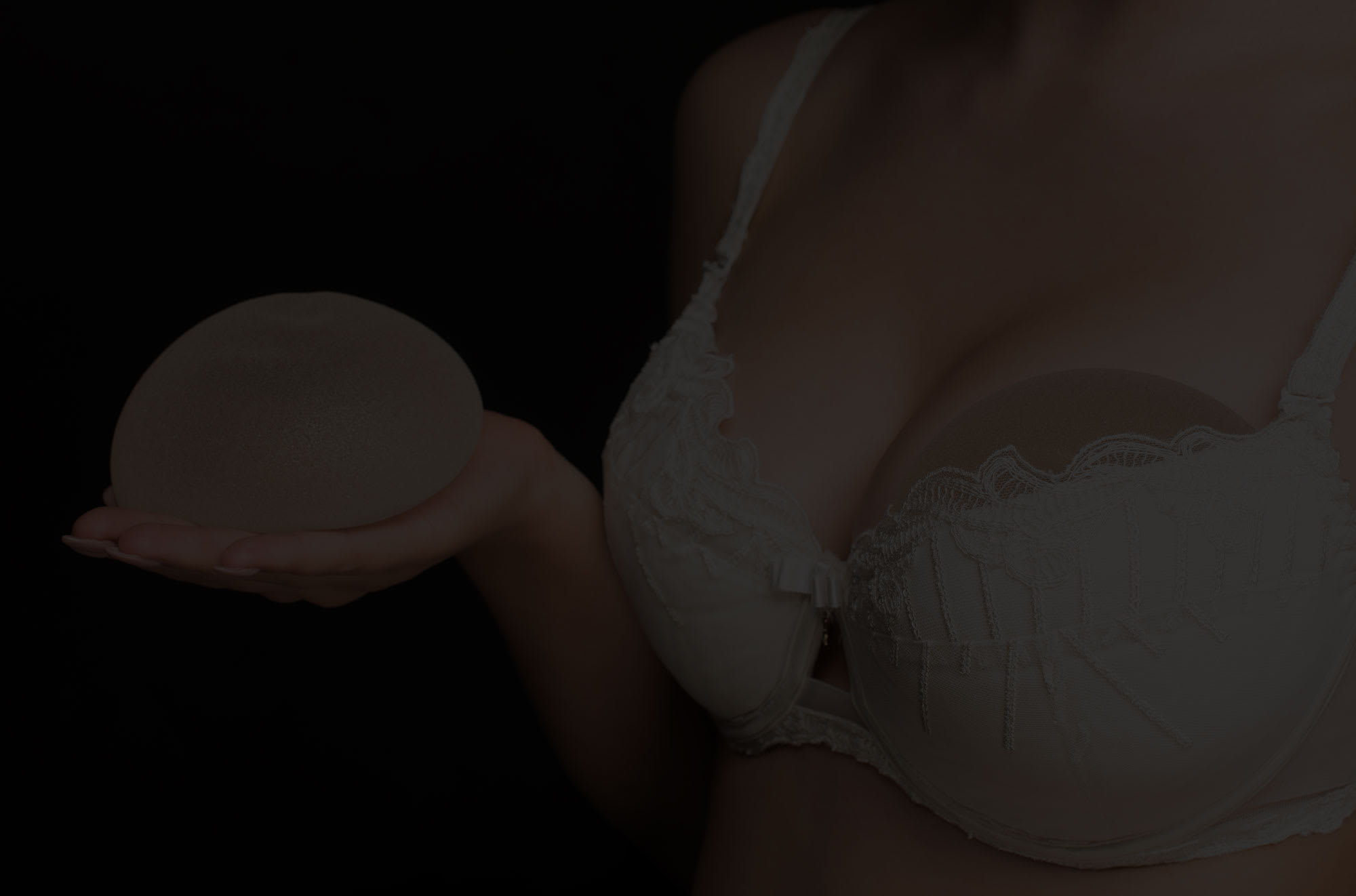 Beautiful woman with large breasts after breast augmentation.