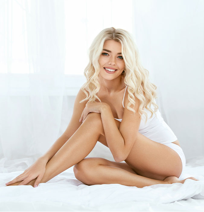 woman-sitting-on-bed