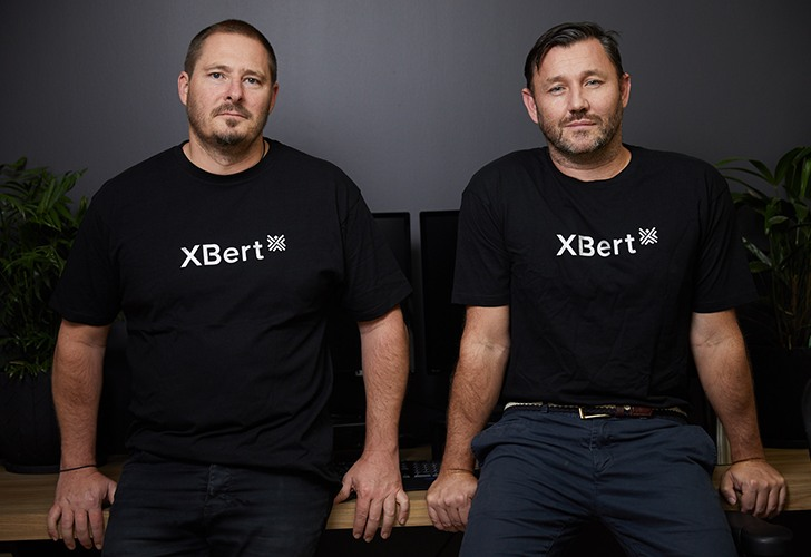 XBert founders Troy Brown and Aaron Wittman looking at the camera.