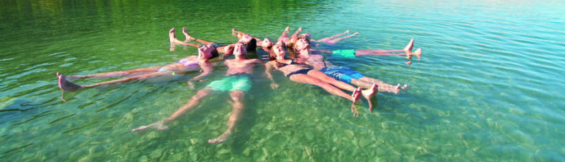 backpackers-at-lake-tekapo-swimming-in-a-star-shape-with-kiwi-experience