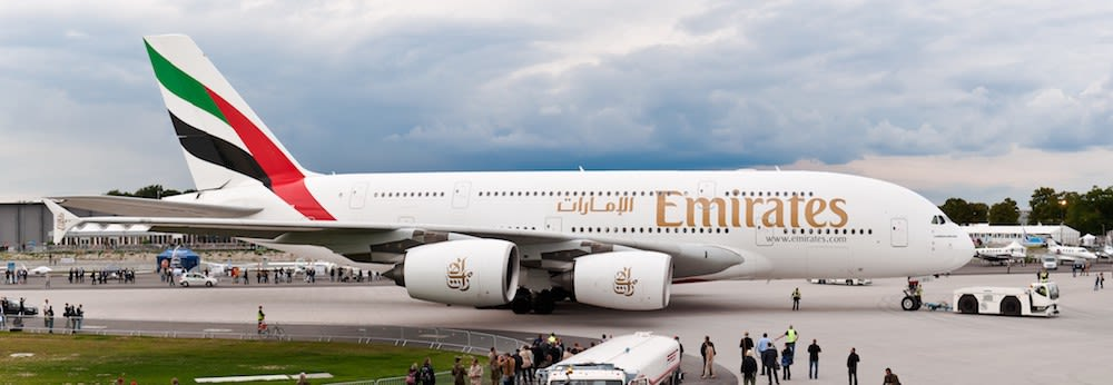 An Airbus A380 being pushed back in an airport