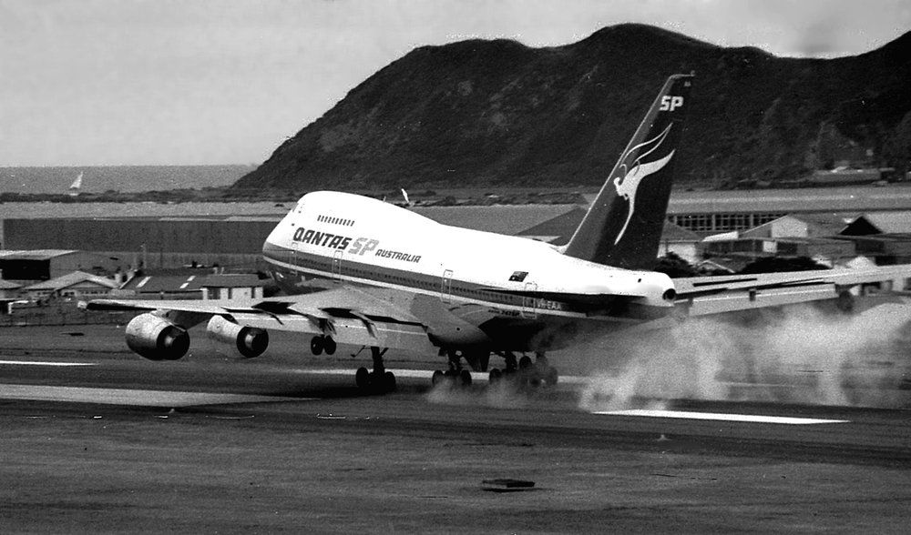 Black and white photo of an old jumbo jet touching down
