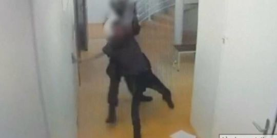 French police officer detained after beating of inmate captured on video