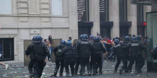 French police fire tear gas at unruly fans celebrating World Cup win