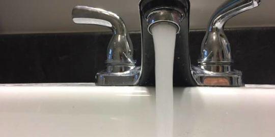 Water main break blamed for yellow water in south London