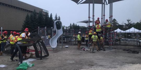 Dozens gather to build Jumpstart playground for accessible play in Winnipeg