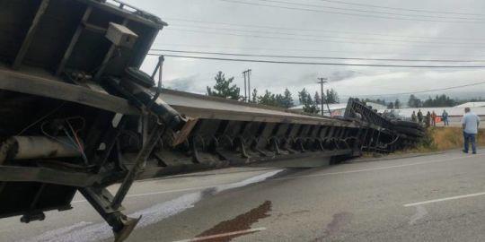 Truck topples over near Vernon