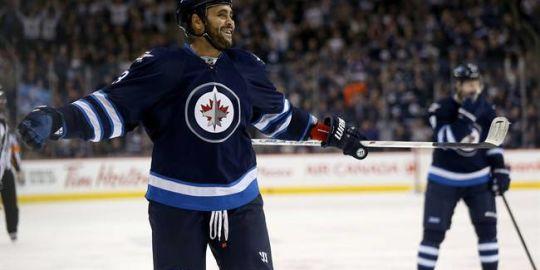 Winnipeg Jets' Dustin Byfuglien out with upper-body injury