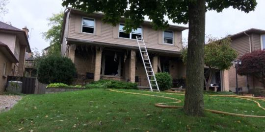 London fire crews douse flames at Byron home