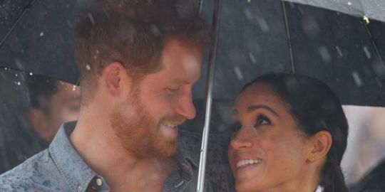 Prince Harry, Meghan Markle share sweet moment under umbrella during Australia tour
