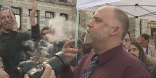 Marijuana advocate hands out free joints to celebrate legal cannabis at B.C. Legislature