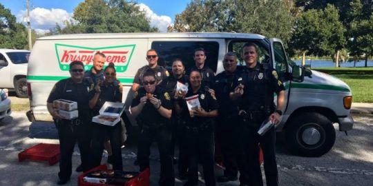Cops track down stolen Krispy Kreme truck, scarf down doughnuts before donating to homeless
