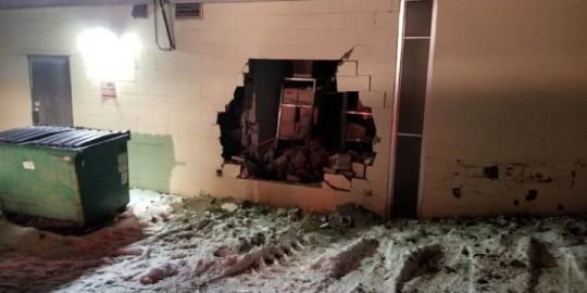 Construction loader used to break through bank wall in northern Alberta