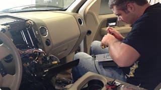 Electrician working inside a car