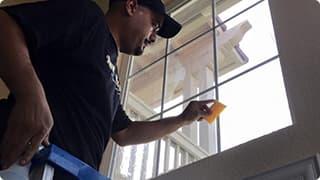 Technician applying  window film in residential home.