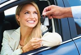 A client receiving her car rental