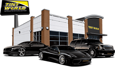 Tint World car dealer with 3 cars in front