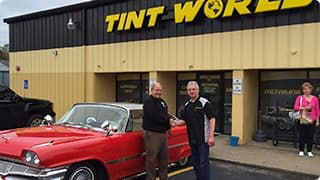 Customer and a Tint world franchisee shaking hands