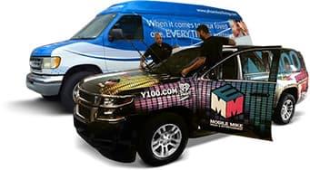 A van and work van displaying wrap