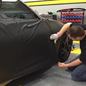 technician working on vehicle