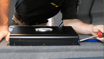 technician installing audio amplifier