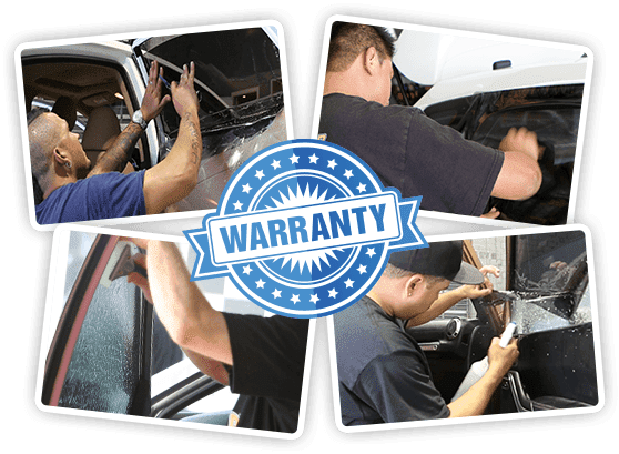Technicians applying film tint on cars