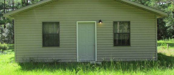 Unfinished Tiny House And Corner 5 Acre Lot In Quiet Neighborhood. $38,500  For Sale
