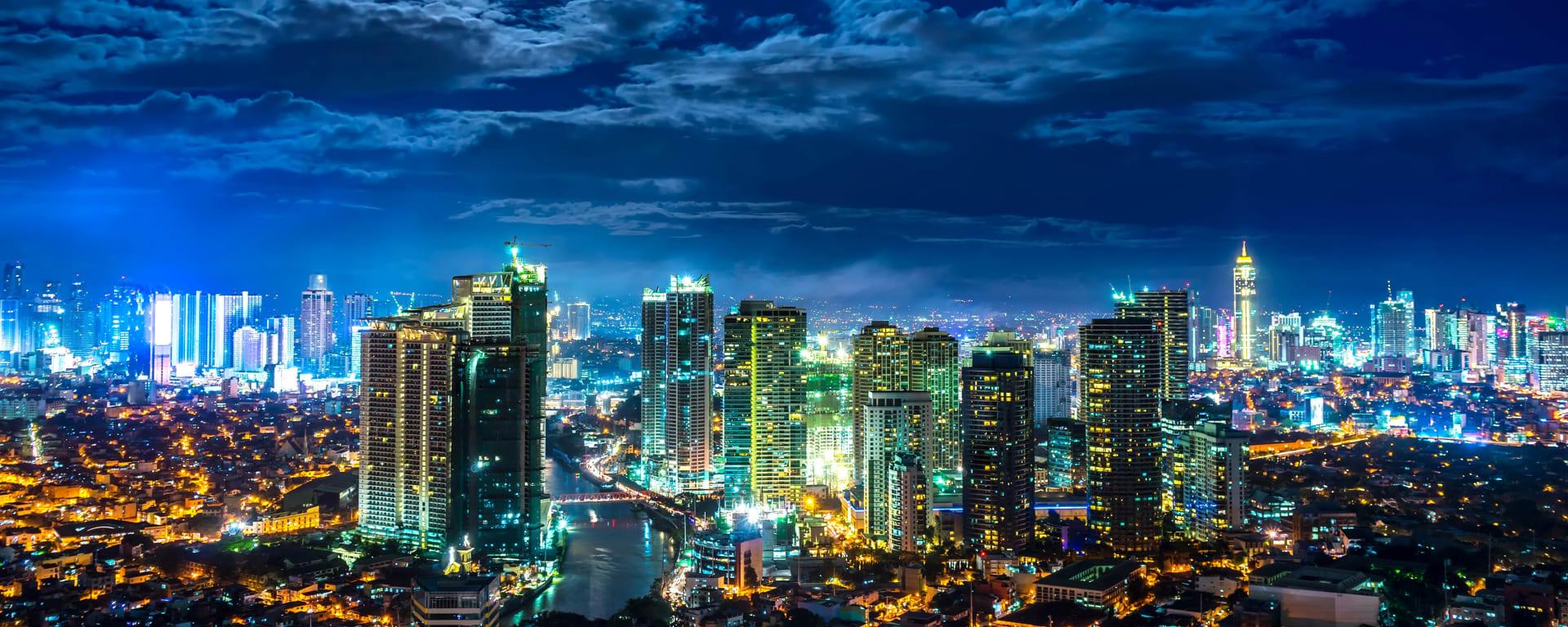 Philippinen entdecken mit Tischler Reisen: Philippinen Manila Skyline Nacht