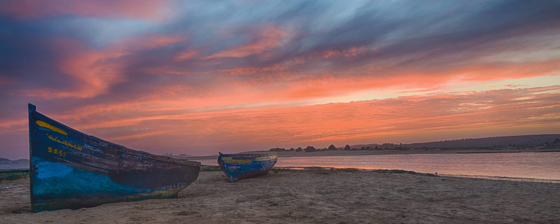 Marokko entdecken mit Tischler Reisen: Marokko Oualidia Strand Sonnenuntergang