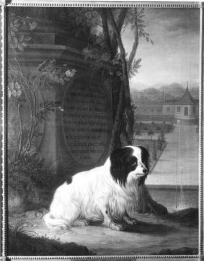 Hund vor einem Denkmal